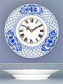 Wall clock with embossed plate